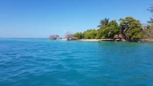Passing between Caye Caulker and the neighboring island to head out to sea