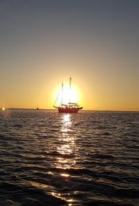 Silhouette of boat against the sunset